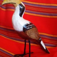 Hand carved and painted wooden bird